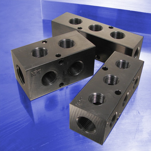 "Pneumatic Manifolds:  90° Output Ports, 1.5"" Spacing"